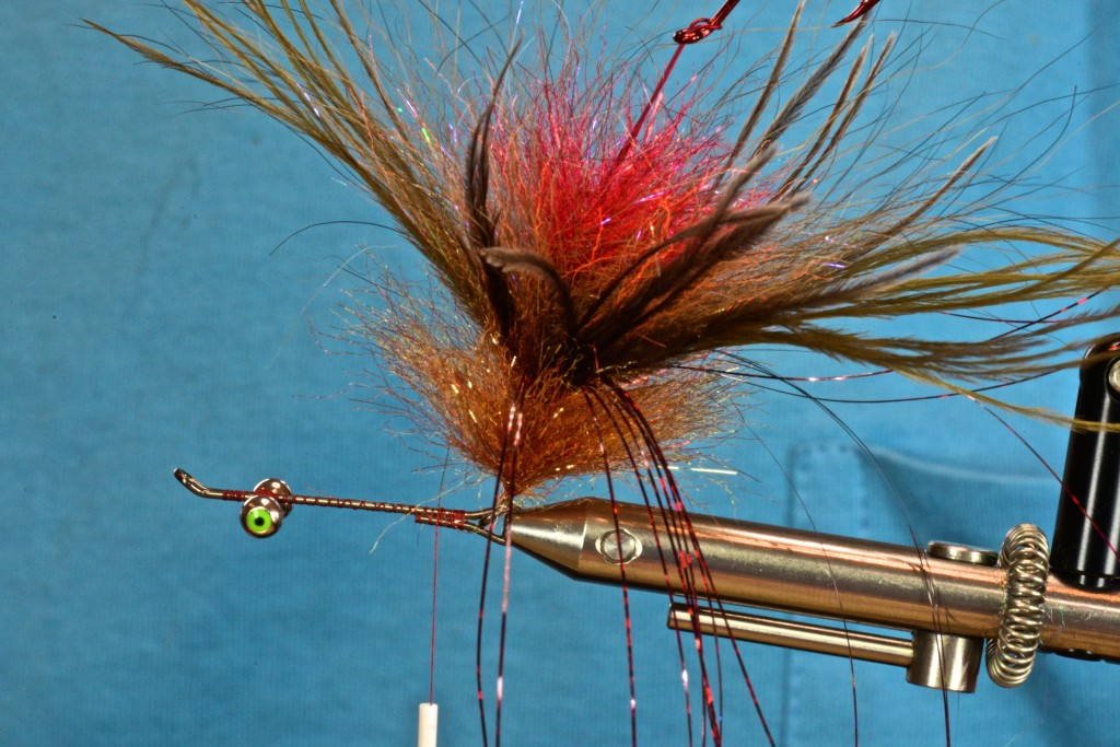 after slippng the rear segment of the fly into the front shank, secure the front shank in the vise/