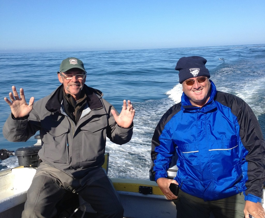 Jay and Tom on the ocean in calm seas.
