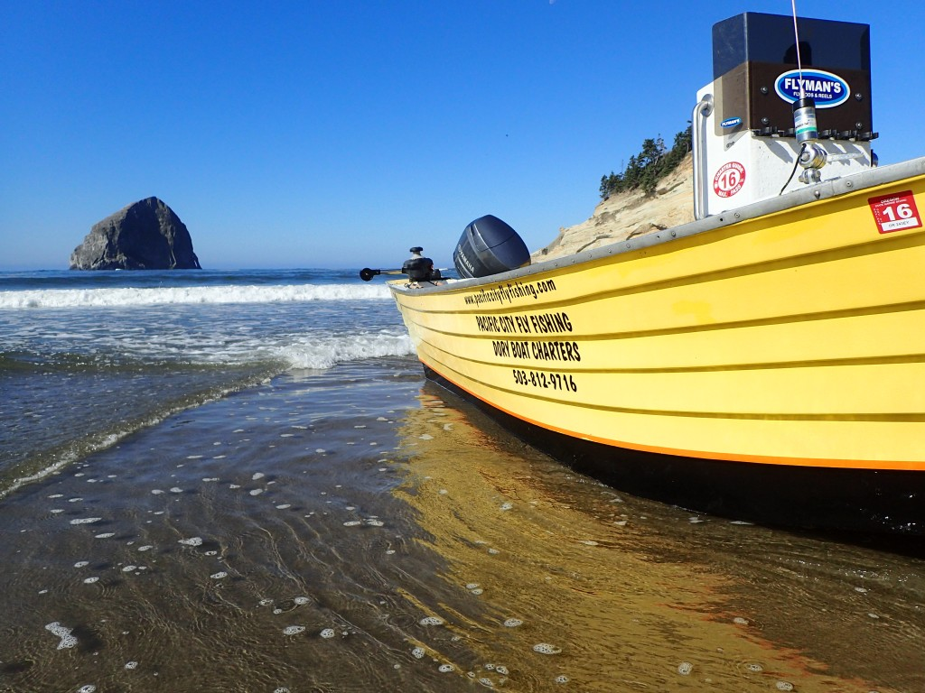 Taking the dory out with Haystack Rock in the background.