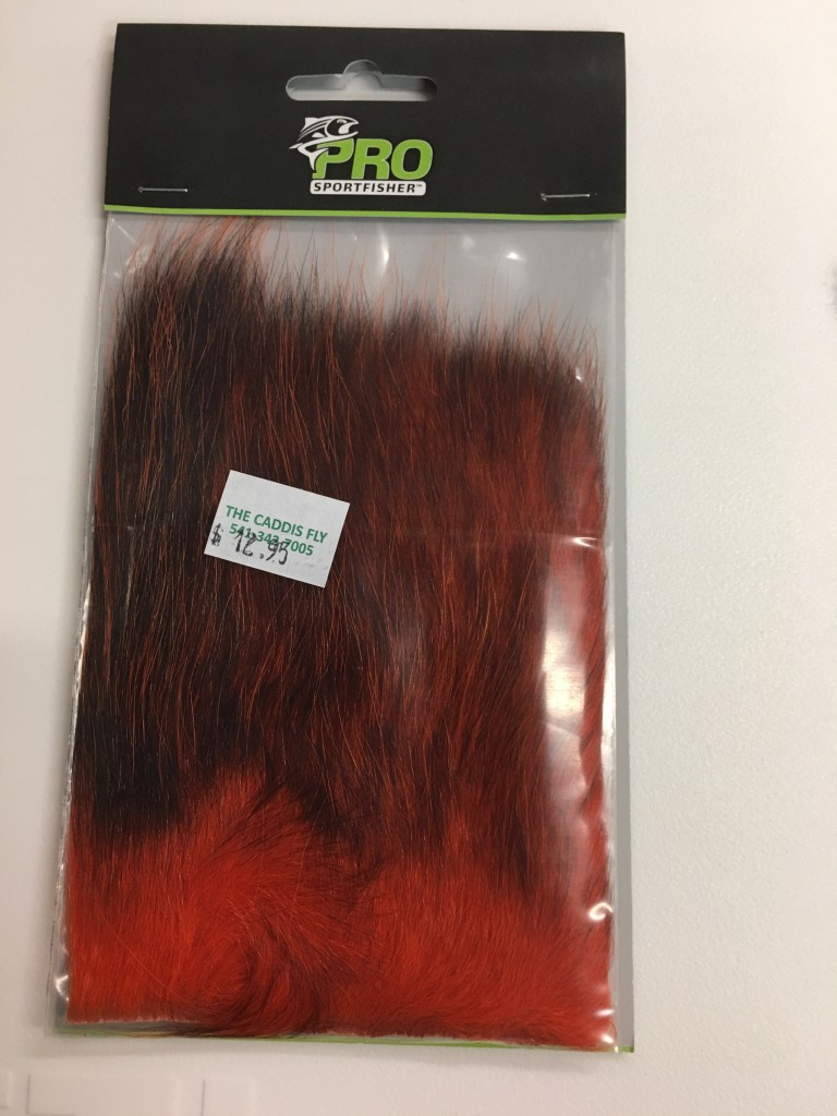 This is a packet of Pro Sportfisher American Possum fur on the hide. This is more often best suited for spinning in a dubbing loop because only a few packets of this fur will be long enough to make for good wings on steelhead and salmon flies. The color of each piece will vary as will the length of fur on each piece. This fur is very different from the tail fur previously discussed.