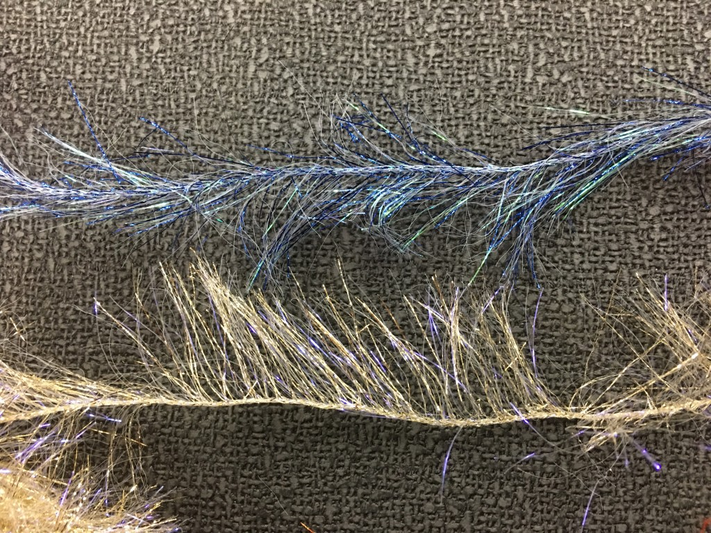 "Senyo's Aqua Veil (upper) and Hareline UV Polar Chenille (lower) shown in comparison.  The strands on both products are roughly 1.25"" long."