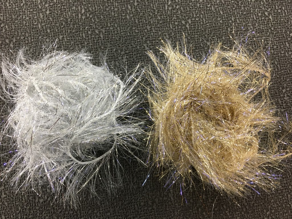 Silver and Gold UV Polar Chenille pictured out of their packages.