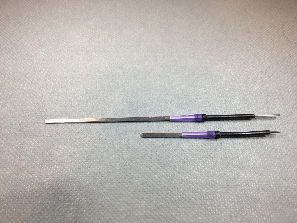 This photo shows a Pro Sportfisher Micro Tube and Hook guard mounted on the regular Flexineedle at top and the shortened needle at bottom. This photo shows a Pro Sportfisher Micro Tube and Hook guard mounted on the regular Flexineedle at top and the shortened needle at bottom.