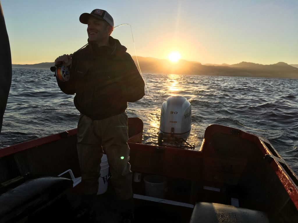 Rob Perkin is ready for a coho to grab with the sun rising in the east.
