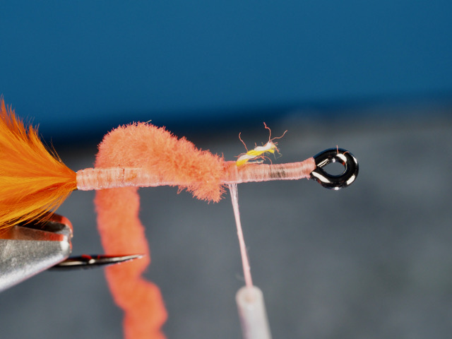 """The thread core of the chenille is tied in with 3 touching wraps of thread. Note that the chenille is tied in at the front of the hook, not the rear. I will wind all the way to the rear with touching wraps of chenille, and then wind with widely spaced wraps of chenille to the front of the fly. This will create a body with """"valleys"""" in the chenille that I will lay my medium oval tinsel into."""